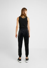 Nike Sportswear - PANT PLUSH - Tracksuit bottoms - black/white - 3