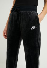 Nike Sportswear - PANT PLUSH - Tracksuit bottoms - black/white - 5