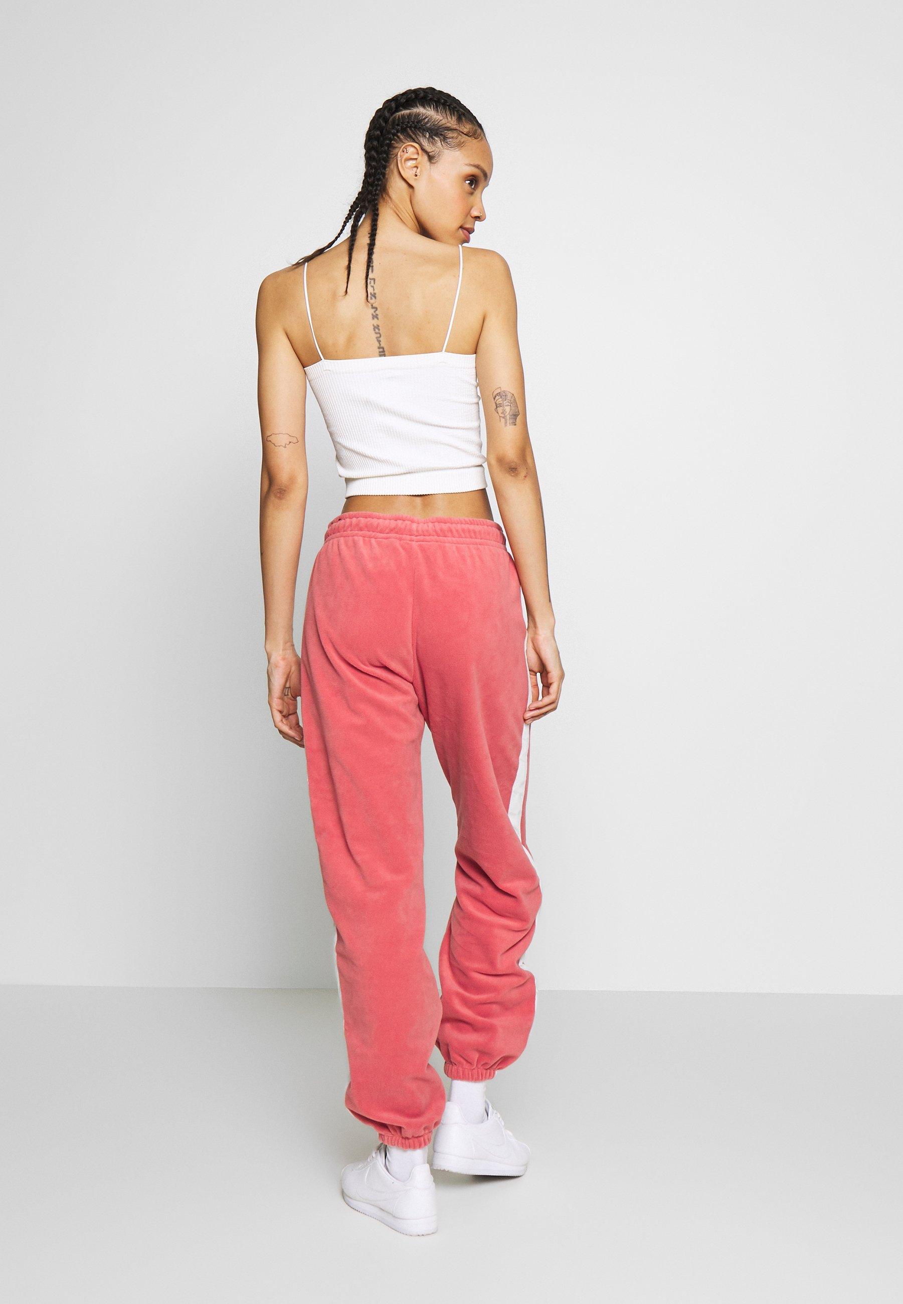 Nike Sportswear Spodnie treningowe - light redwood