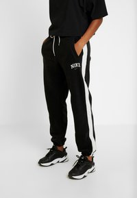 Nike Sportswear - Tracksuit bottoms - black/sail - 0