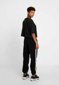 Nike Sportswear - Tracksuit bottoms - black/sail - 3