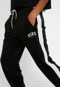Nike Sportswear - Tracksuit bottoms - black/sail - 6