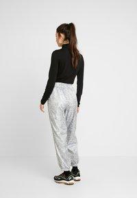 Nike Sportswear - PANT - Tracksuit bottoms - white/black - 2