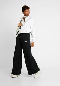 Nike Sportswear - PANT  - Träningsbyxor - black/white - 1