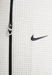 Nike Sportswear - CITY RDY  - Tracksuit bottoms - light bone/black - 5