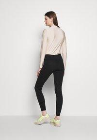 Nike Sportswear - Leggings - Trousers - black - 2
