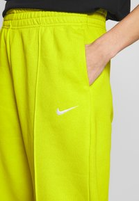 Nike Sportswear - PANT TREND - Tracksuit bottoms - bright cactus/(white) - 4