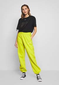 Nike Sportswear - PANT TREND - Tracksuit bottoms - bright cactus/(white) - 1