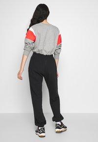 Nike Sportswear - PANT TREND - Spodnie treningowe - black/white - 2