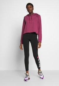 Nike Sportswear - CLUB - Leggings - Trousers - black/white - 1