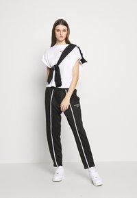 Nike Sportswear - PANT - Jogginghose - black/black/white - 1