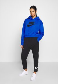 Nike Sportswear - W NSW SWSH PANT FT - Tracksuit bottoms - black/white - 1