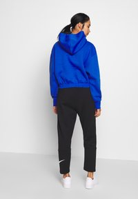 Nike Sportswear - W NSW SWSH PANT FT - Tracksuit bottoms - black/white - 2