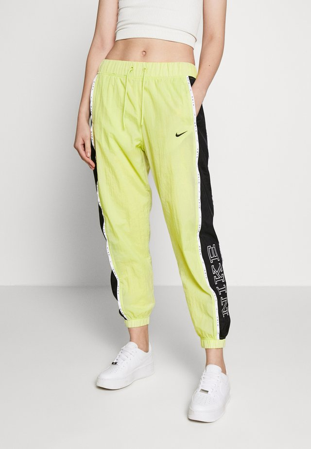 PANT PIPING - Tygbyxor - limelight/black