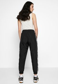 Nike Sportswear - PANT PIPING - Kalhoty - black/white - 2