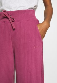 Nike Sportswear - PANT - Tracksuit bottoms - mulberry rose - 4