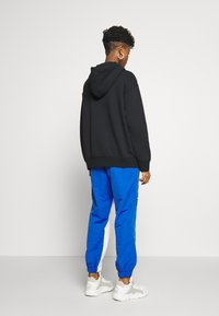 Nike Sportswear - W NSW ICN CLSH PANT MIXED OS - Tracksuit bottoms - birch heather - 2