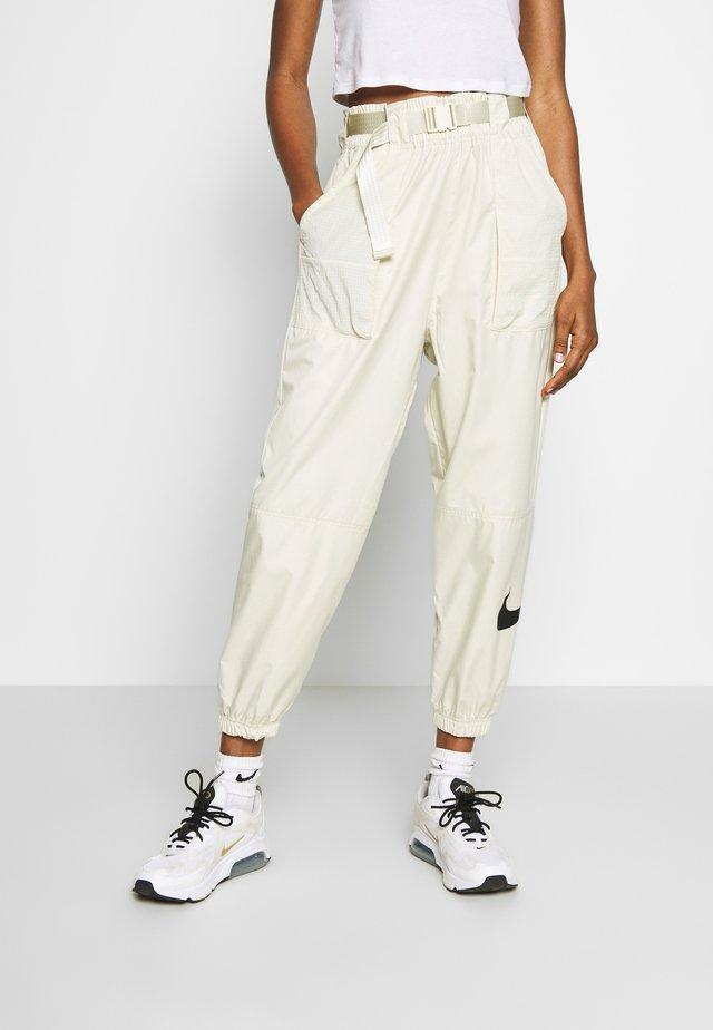 PANT - Pantalones deportivos - fossil/black