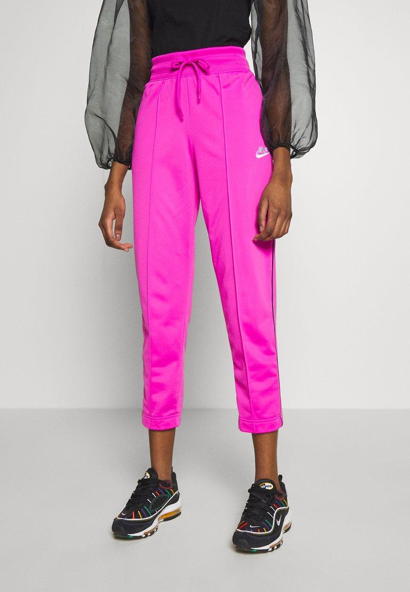 Nike Sportswear - Teplákové kalhoty - fire pink/black