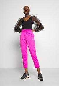Nike Sportswear - Teplákové kalhoty - fire pink/black - 1