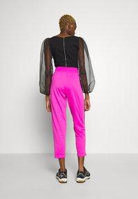 Nike Sportswear - Teplákové kalhoty - fire pink/black - 2