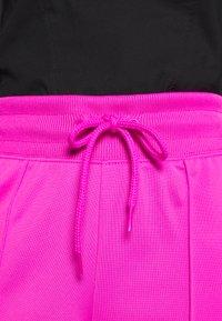 Nike Sportswear - Teplákové kalhoty - fire pink/black - 5