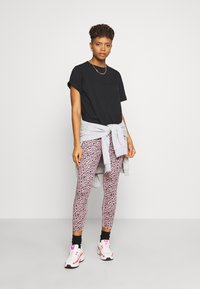 Nike Sportswear - Leggings - Trousers - pink - 1