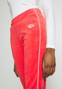 Nike Sportswear - Tracksuit bottoms - track red - 3