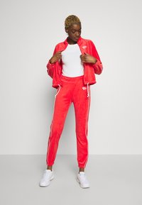 Nike Sportswear - Tracksuit bottoms - track red - 1