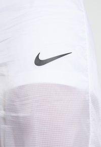 Nike Sportswear - INDIO PANT - Spodnie treningowe - white/black - 4
