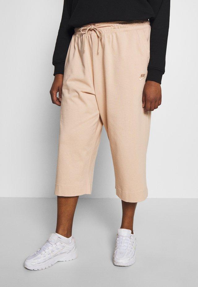 W NSW CAPRI JRSY PLUS - Pantalones deportivos - shimmer