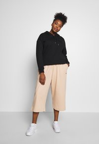Nike Sportswear - CAPRI - Pantaloni sportivi - shimmer - 1