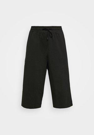 CAPRI - Teplákové kalhoty - black