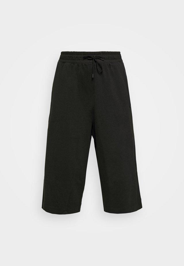 W NSW CAPRI JRSY PLUS - Pantalones deportivos - black