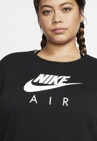 Nike Sportswear - AIR  - Sukienka z dżerseju - black - 4