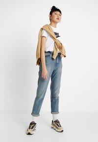 Nike Sportswear - TEE ICON FUTURA - Print T-shirt - white/black - 1