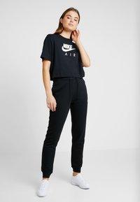 Nike Sportswear - AIR  - Camiseta estampada - black - 1