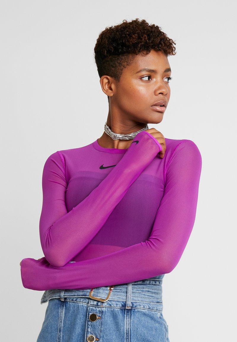 Nike Sportswear - CITY BODYSUIT - Long sleeved top - vivid purple