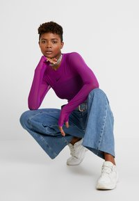 Nike Sportswear - CITY BODYSUIT - Top sdlouhým rukávem - vivid purple - 1