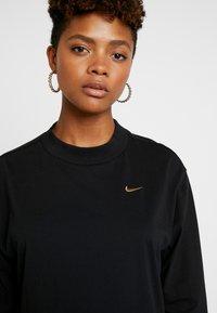 Nike Sportswear - Long sleeved top - black/metallic gold - 4