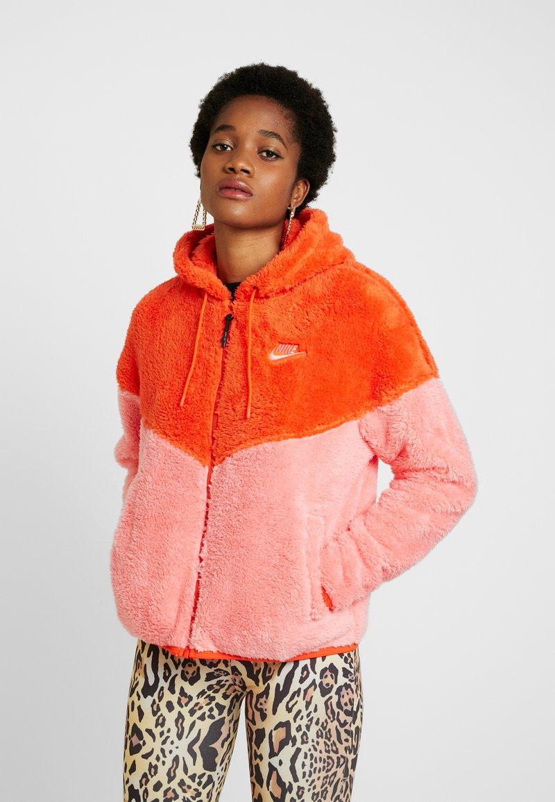 Nike Sportswear - WINTER - Fleece jacket - team orange/sunblush/black