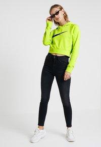 Nike Sportswear - Kapuzenpullover - cyber/black - 1