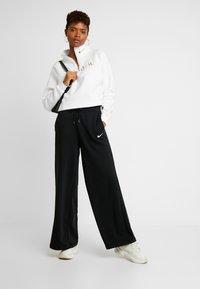 Nike Sportswear - FUNNEL ZIP SHINE - Sweatshirt - white/metallic gold - 1