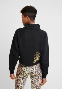 Nike Sportswear - FUNNEL ZIP SHINE - Sweater - black/metallic gold - 2