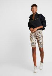 Nike Sportswear - FUNNEL ZIP SHINE - Sweatshirt - black/metallic gold - 1