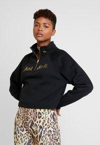 Nike Sportswear - FUNNEL ZIP SHINE - Sweater - black/metallic gold - 0