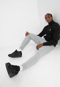 Nike Sportswear - TECH - Pantaloni sportivi - grey - 1