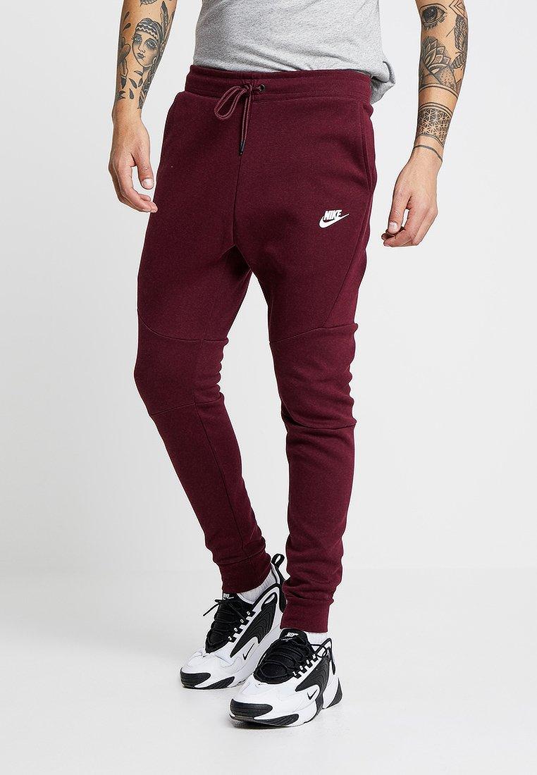 Nike Sportswear - TECH - Pantalon de survêtement - night maroon