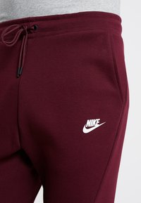 Nike Sportswear - TECH - Spodnie treningowe - night maroon - 3