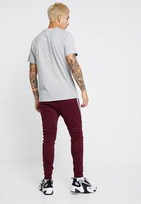 Nike Sportswear - TECH - Spodnie treningowe - night maroon - 2